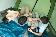 Friends in tent together Stock Photos