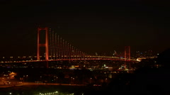 Bosporus Bridge illuminated with red lights at night at Istanbul - stock footage