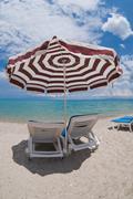 umbrella and sun beds on the beach - stock photo