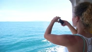 Stock Video Footage of Woman Taking Picture on a Yacht with Cell Phone. Slow Motion.