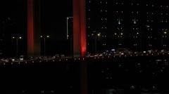 Close up of traffic on Bosphorus Bridge at night, Istanbul Stock Footage