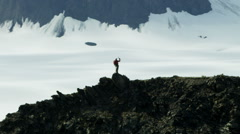 Aerial Male Climber Alaska Glacial Mountain Range Outdoors Success 4K RED EPIC Stock Footage