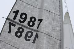 sails flapping in the breeze with number 1987 - stock photo