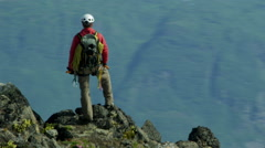 Glacial Ice Snow Aerial Male Climber Hiking Success Alaska Travel 4K RED EPIC - stock footage