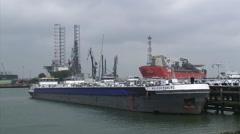 Inland tanker berthed - medium shot + pan Oasis of the Seas cruise ship Stock Footage