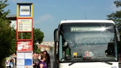 people get in the bus (queue) - commuter people - timelapse - bus stop - street - stock footage