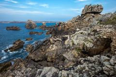 Sharp rocky coastline Stock Photos