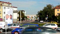 Housing estate (buildings - houses) - road with passing cars - city - nature Stock Footage