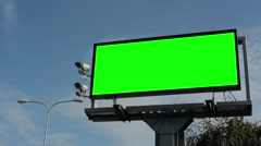 Information billboard in the city near road - green screen - security cameras  Stock Footage