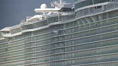 Side view + zoom out Oasis of the Seas cruise ship, waiting to dock at shipyard Stock Footage