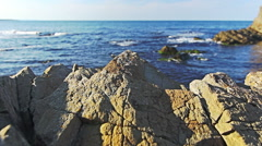 Dolly shot of paradise Sea coast with rocks and cliffs. - stock footage