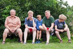 Grandfather and his beloved ones boys - stock photo