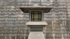 Stone lantern in front of waterfall Stock Footage