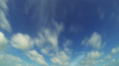 Time lapse of clouds moving through blue sky. 4K Stock Footage