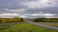 Timelapse of the suburban highway traffic in autumn Stock Footage