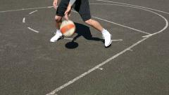 Basketball player dribbles the ball with skill before shooting Stock Footage