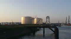 Botlek oil terminal + pan Oasis of the Seas cruise ship, docking at shipyard Stock Footage