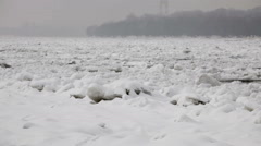 Frozen river Danube at winter - ice floating over river surface Stock Footage