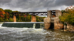 4K UltraHD Motion Controlled pan of a dam and railway bridge in fall, timelapse - stock footage