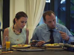 Business couple eating meal and using smartphone and tablet computer at hom NTSC Stock Footage