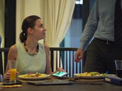 Business couple eating dinner and chatting at home in the evening NTSC Stock Footage