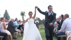 Bride and Groom Dance Down the Aisle - stock footage