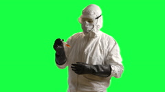 Hazmat doctor looking at a sample green screen Stock Footage