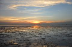 Sunset view at wetland sea coast - stock photo