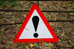 Red and white triangular warning sign Stock Photos