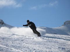 snowboarder carving a turn on the piste - stock photo