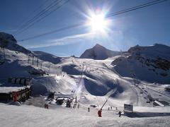 Winter alpine mountain scene under a blue sky Stock Photos