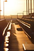 symmetrical regular pattern grandstand seating arrangement at sunset - stock photo