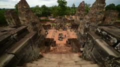 Looking Down Temple Steps as Tourists walk around the Altar - Angkor Wat Stock Footage