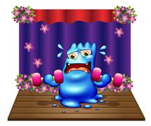 Stock Illustration of A blue monster exercising in the middle of the stage