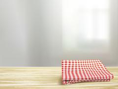 Closeup of wooden desk and tablecloth in room Stock Illustration