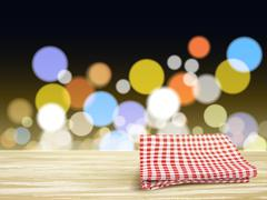 Stock Illustration of closeup of wooden desk and tablecloth over night sight
