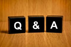 q&a or questions and answers word on black block - stock photo