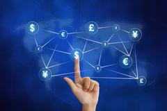 Hand pushing global currency networking Stock Photos