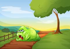 Stock Illustration of A tired monkey resting in the middle of the pathway in the hill
