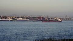 Merchant haul container ship crossing Bosporus Bridge Stock Footage