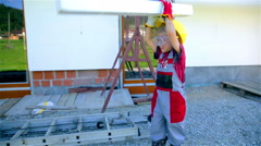 Young worker with helmet and gloves playing with styrofoam stick Stock Footage