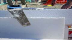 Person marking before sawing white styrofoam Stock Footage
