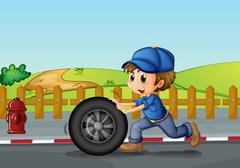 Stock Illustration of A boy wearing a hat pushing a wheel along the road