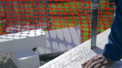 Sawing through big styrofoam board jib shot - stock footage