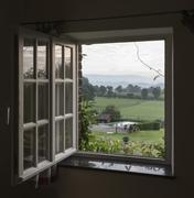 see through window with landscape - stock photo