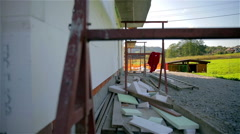 Wide shot of work site with styrofoam on house walls and ground Stock Footage