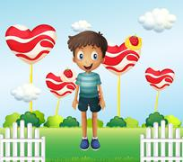 A smiling young boy standing in the garden with giant heart lollipops Stock Illustration