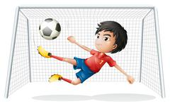 A boy playing soccer wearing a red uniform - stock illustration