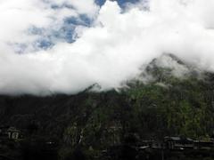 Mountain village on a monsoon day Stock Photos
