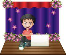 A smiling young boy sitting in the middle of the stage holding an empty signage - stock illustration